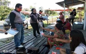 KPU Kalteng Bagikan Masker kepada Masyarakat Palangka Raya untuk Cegah Covid-19