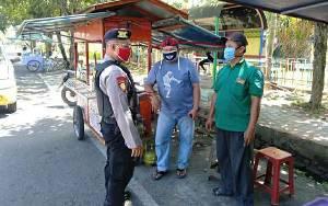 Personel Polsek Selat Rutin Lakukan Patroli Dialogis Selama PSBB