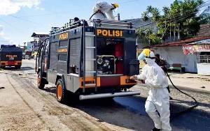 Polda Kalteng Semprotkan 16 Ribu Liter Disinfektan Cegah Covid-19