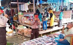 Polsek Dusun Hilir Sambangi Pasar Ajak Masyarakat Terapkan Protokol Kesehatan