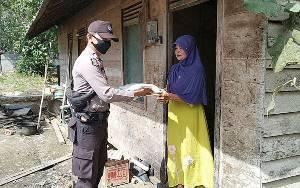 Jumat Berkah, Polsek Dusun Tengah Bagikan 100 Kantong Beras