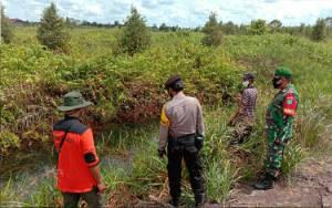 Bhabinkamtibmas Polsek Kapuas Muring Patroli Terpadu Antisipasi Karhutla di Dadahup