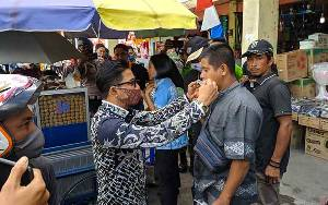 Kasus Covid-19 di Kotim Capai 165 Terkonfirmasi, TNI/Polri Bersama Pemerintah Bagikan 10.000 Masker