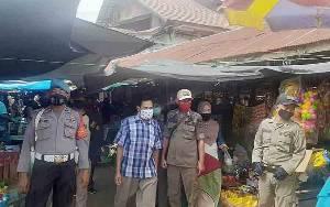 Polsek Dusun Tengah Operasi Yustisi di Pasar Ampah