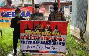 Anggota Polsek Mantangai Sosialisasikan Pilkada Damai