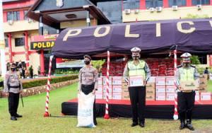 Kapolda Kalteng Serahkan APD dan Puluhan Ton Beras ke Polres
