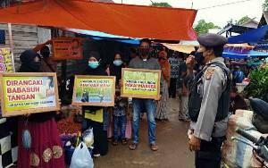 Polsek Kapuas Timur Sosialisasikan Penerapan Protokol Kesehatan di Pasar