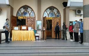 TNI-Polri Lakukan Pengamanan Ibadah Natal Sambil Ingatkan Protokol Kesehatan