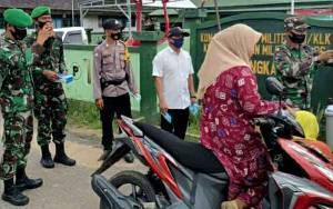 Petugas Gabungan di Kapuas Murung Ingatkan Masyarakat Gunakan Masker