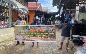 Anggota Polsek Kahut Sosialisasikan Setop Illegal Mining