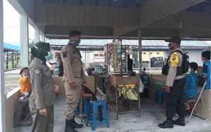 Personel Gabungan Operasi Yustisi di Pasar Bangun Harja