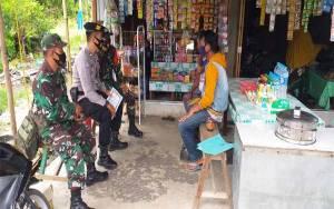 TNI - Polri di Kecamatan Kapuas Timur Edukasi Warga untuk Terapkan Protokol Kesehatan
