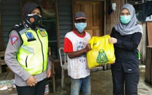 Tim Hasupa Hasundau Polwan Polres Kapuas Kembali Salurkan Bantuan untuk Warga di Tengah Pandemi