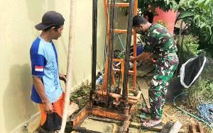 Atasi Kesulitan Air Bersih, Prajurit Kodim 1013 Muara Teweh Bantu Warga Buat Sumur Bor
