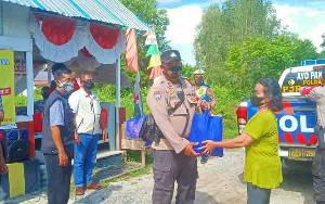 Polda Kalteng Distribusikan Bansos untuk Masyarakat Terdampak Covid-19